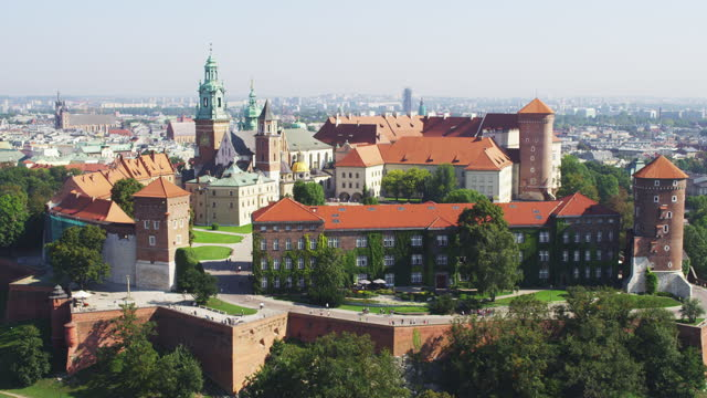 aerial view of krakow's main square, city skyline and architectural details - clock tower stock videos & royalty-free footage