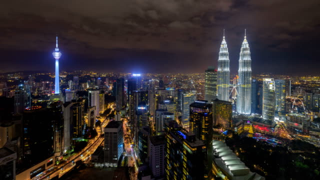vídeos de stock, filmes e b-roll de aerial view of kuala lumpur city centre skyline during a clear night before the eve of new year - torre menara kuala lumpur
