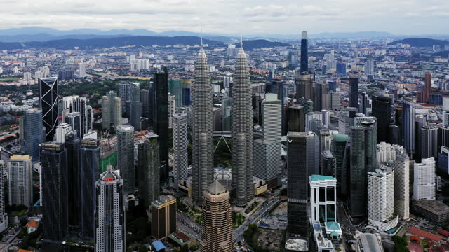 stockvideo's en b-roll-footage met aerial view of kuala lumpur financial district at daytime, malaysia - petronas twin towers