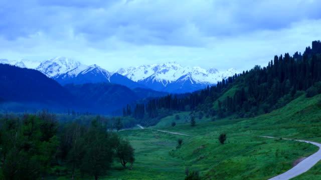 stockvideo's en b-roll-footage met aerial view of kuardning geru snow mountain and forests - watervorm