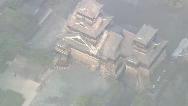 Aerial view of Kumamoto castle damaged by consecutive earthquake attacks on 14th night captured in the next morning Zooming in on the collapsed part