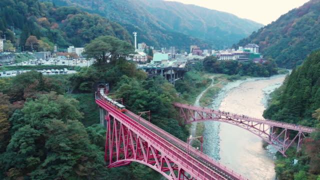 aerial view of kurobe gorge railway in autumn season, toyama, japan. - toyama prefecture stock videos and b-roll footage