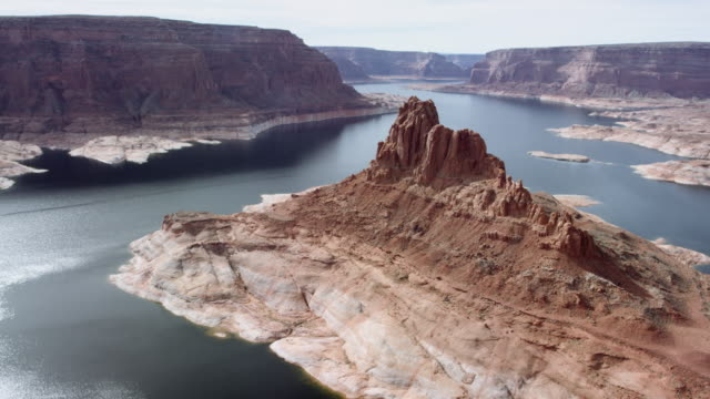 Aerial view of lake surrounded by steep canyons