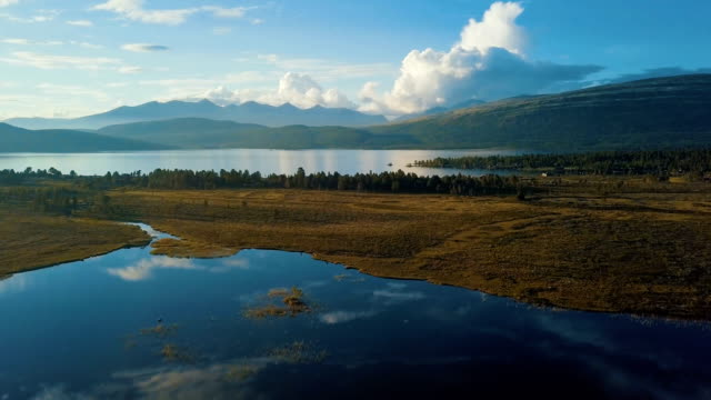 aerial view of lake with reflection in rondane national park, norway - scandinavia stock videos & royalty-free footage