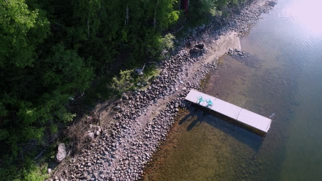 aerial view of lakeshore & dock - lakeshore stock videos & royalty-free footage