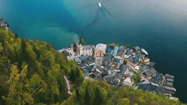 aerial view of lakeside village of hallstatt in austria - traditionally austrian stock videos & royalty-free footage
