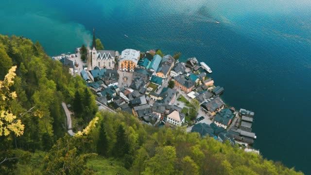 aerial view of lakeside village of hallstatt in austria - postcard stock videos & royalty-free footage