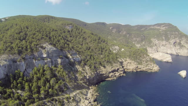 aerial view of land and sea in ibiza, spain - rocky coastline stock videos & royalty-free footage