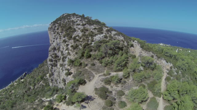 aerial view of land, cliffs and sea in ibiza, spain - rocky coastline stock videos & royalty-free footage