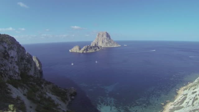Aerial view of land, cliffs and sea in Ibiza, Spain