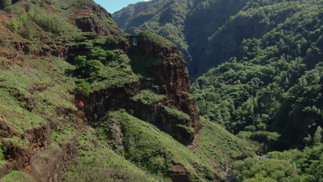 Aerial view of land formations in mountainous valley of the Hawaiian Island of Kauai.