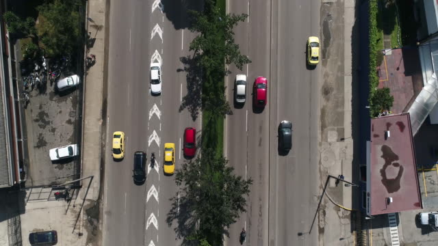 Aerial view of land vehicles moving on city streets, Bogota, Colombia