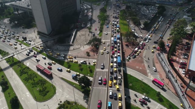 Aerial view of land vehicles moving on highways in city, Bogota, Colombia