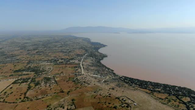 vídeos y material grabado en eventos de stock de aerial view of langano lake and surrounding shore/ ethiopia - etiopía