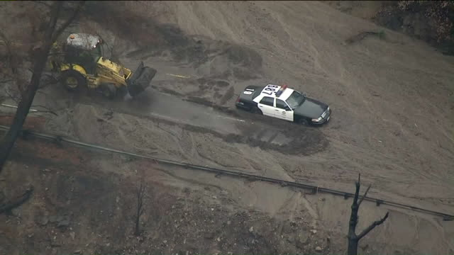 KTLA Aerial View of LAPD Cruiser Stuck in Mudflow on La Tuna Canyon Road amid Tuesday's downpour