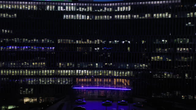 ws zo/ aerial view of large building at night - abundance stock videos & royalty-free footage