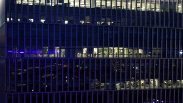 ws pan/ aerial view of large building at night - abundance stock videos & royalty-free footage