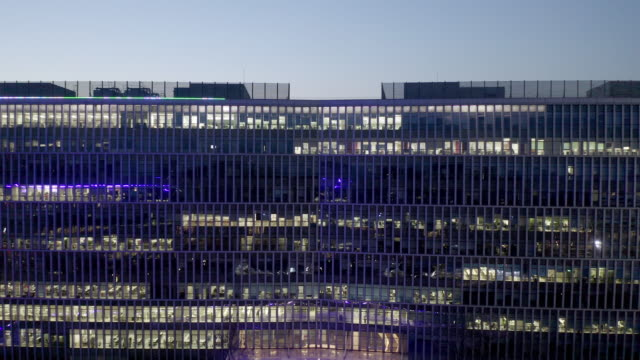 ws zi/ aerial view of large building at night - abundance stock videos & royalty-free footage