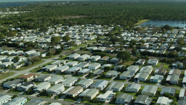 aerial view of large manufactured home community in florida - florida us state stock videos & royalty-free footage