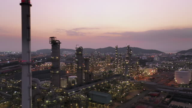 aerial view of large oil refinery at dusk - oil refinery stock videos & royalty-free footage