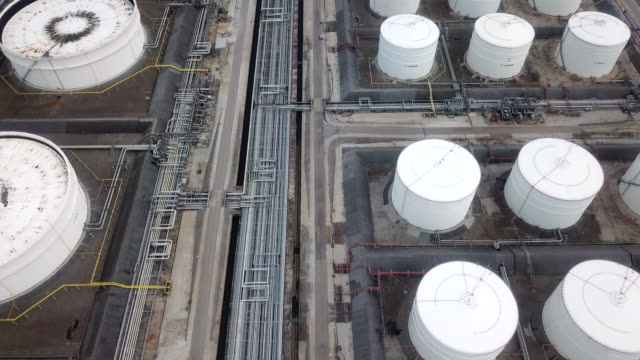 aerial view of large oil refinery facilities - storage tank stock videos and b-roll footage