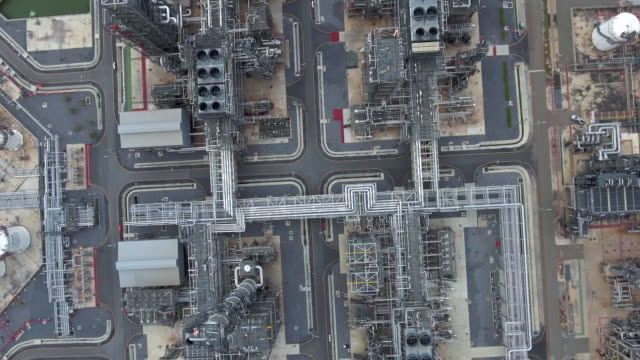 aerial view of large oil refinery facilities - factory stock videos & royalty-free footage