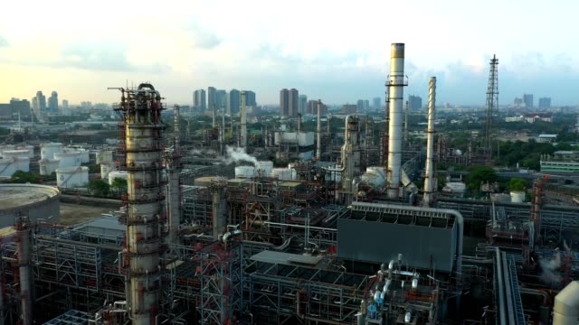 4k aerial view of large oil refinery plant - factory stock videos & royalty-free footage