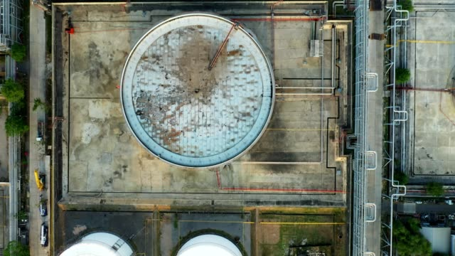 4k aerial view of large oil refinery plant - fuel storage tank stock videos and b-roll footage