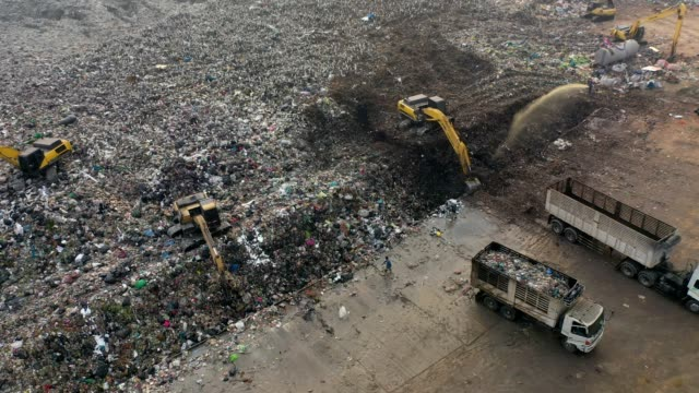 4k aerial view of large stack garbage dump - gestione dei rifiuti video stock e b–roll