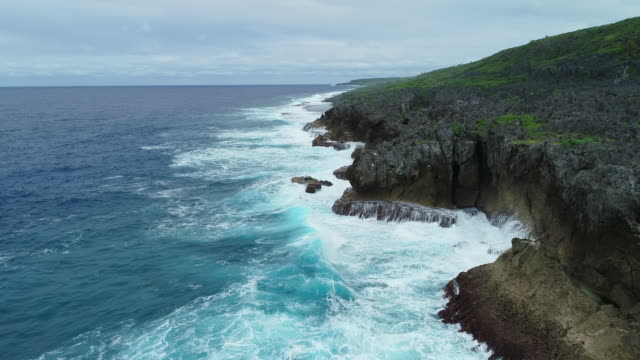 aerial view of large waves crashing onto niue's rocky eastern coastline - polynesia stock videos & royalty-free footage