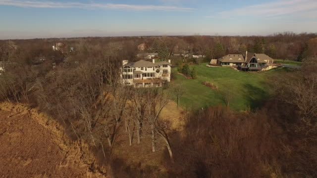 aerial view of large white house with person walking on sunny deck - illinois stock videos & royalty-free footage