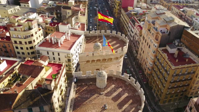aerial view of las torres de quart and the the flag of valencia and spain - スペイン国旗点の映像素材/bロール