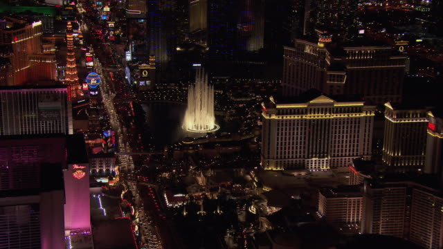 aerial view of las vegas boulevard and resorts and casinos at night, nevada, united states of america. - the palazzo las vegas stock videos & royalty-free footage