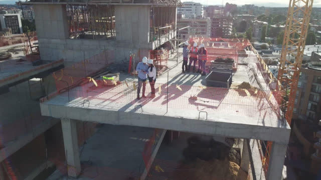 aerial view of latin american workers at a construction site - work helmet stock videos & royalty-free footage