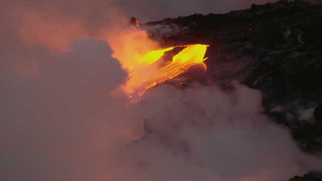 Aerial view of lava flowing into the ocean in Hawaii Volcanoes National Park.