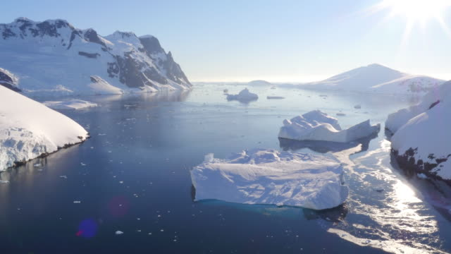 aerial view of lemaire channel, antarctica at sunset - antarctica drone stock videos & royalty-free footage
