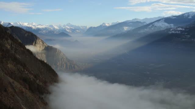 stockvideo's en b-roll-footage met luchtfoto van d'ovronnaz les bains - zwitserland