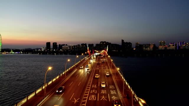 aerial view of li lake bridge park at dusk - east china stock videos & royalty-free footage