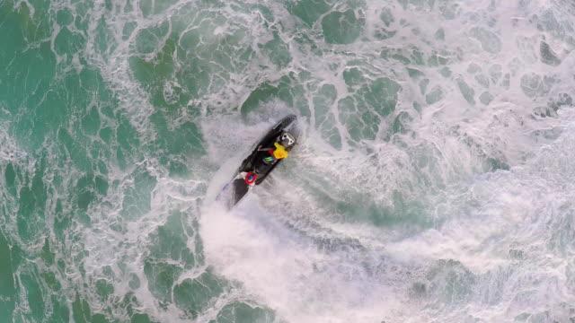 aerial view of lifeguard surf rescue jet ski personal watercraft in hawaii. - windkraftanlage stock-videos und b-roll-filmmaterial