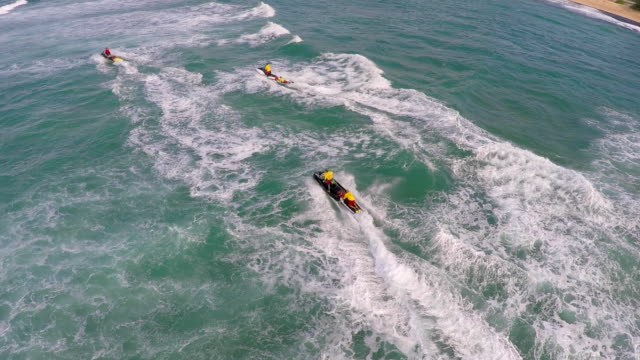 aerial view of lifeguard surf rescue jet ski personal watercraft in hawaii. - bagnino video stock e b–roll