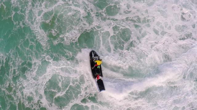 stockvideo's en b-roll-footage met aerial view of lifeguard surf rescue jet ski personal watercraft in hawaii. - slow motion - badmeester
