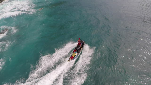 aerial view of lifeguard surf rescue jetski personal watercraft in hawaii. - rescue stock videos & royalty-free footage