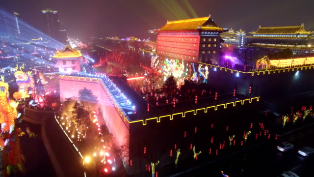 aerial view of lighting show in south gate of ancient city wall for celebrate chinese spring festival / xi'an, shaanxi, china - chinese culture stock videos & royalty-free footage