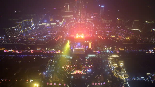 aerial view of lighting show in south gate of ancient city wall for celebrate chinese spring festival / xi'an, shaanxi, china - chinesisches laternenfest stock-videos und b-roll-filmmaterial