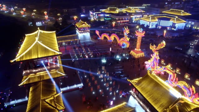 aerial view of lighting show in tang paradise city for celebrate chinese spring festival / xi'an, shaanxi, china - fairground stock videos and b-roll footage