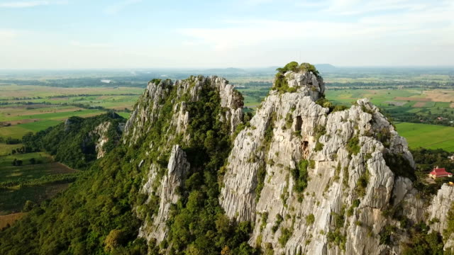 aerial view of limestone mountain in thailand - midday stock videos & royalty-free footage