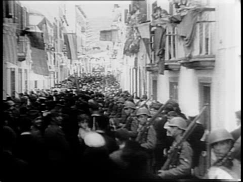 aerial view of lisbon harbors / president of portugal oscar carmona walks past soldiers saluting / president carmona waves from balcony / map of... - atlantikinseln stock-videos und b-roll-filmmaterial