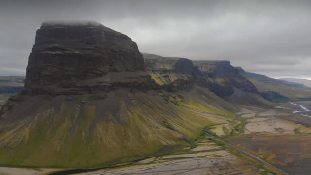 aerial view of lómagnúpur, iceland - butte rocky outcrop stock videos & royalty-free footage