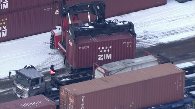 aerial view of loading cargo container to truck at uiwang integrated freight terminal - cargo container stock videos & royalty-free footage