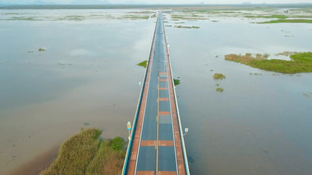 aerial view of local road trip in thailand, phatthalung | highway 3073 - longest sea bridge in thailand - single track stock videos and b-roll footage